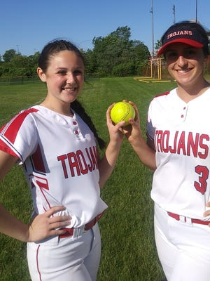 Bridgewater-Raynham softball players Julia Ferry, left, and Summer Sheerin hold up a softball after Ferry tossed a no-hitter against Brockton.