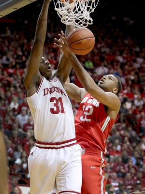 Indiana Hoosiers center Thomas Bryant (31) dunks and is fouled by Ohio State Buckeyes center Trevor Thompson (32).