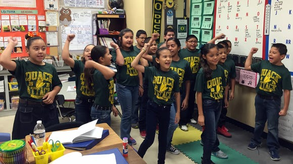 Johanna O'Donnell Intermediate School fourth-graders perform the cheer they made up to go with their assigned college, the University of Oregon.