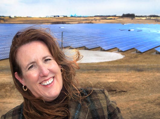 Women are doing important work in the tech industry in Central Indiana. For example, Lisa Laughner is the founder, president and CEO of Go Electric, an Indianapolis company that makes micro power grids used to integrate multiple sustainable and traditional power sources, including solar energy panels and wind turbines. She is shown in front of a solar field at the Indianapolis International Airport on Tuesday, March 25, 2014. (Her company did not work on that project, but micro power grids are used in such technology.)
