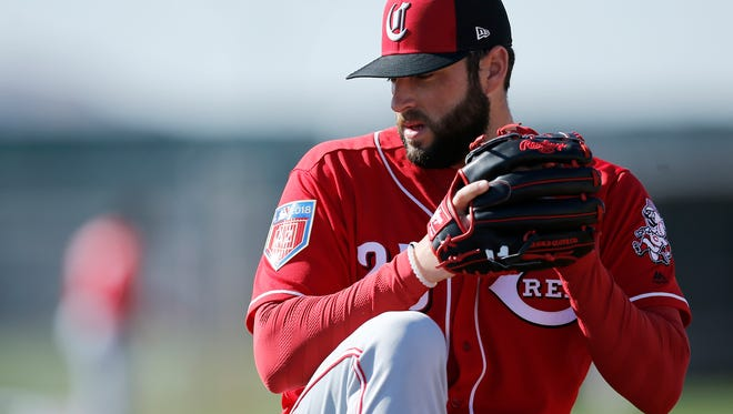 Cincinnati Reds relief pitcher Cody Reed (25) winds up to make a throw in warmups during practice at the Cincinnati Reds training complex in Goodyear, Ariz., on Wednesday, Feb. 21, 2018.