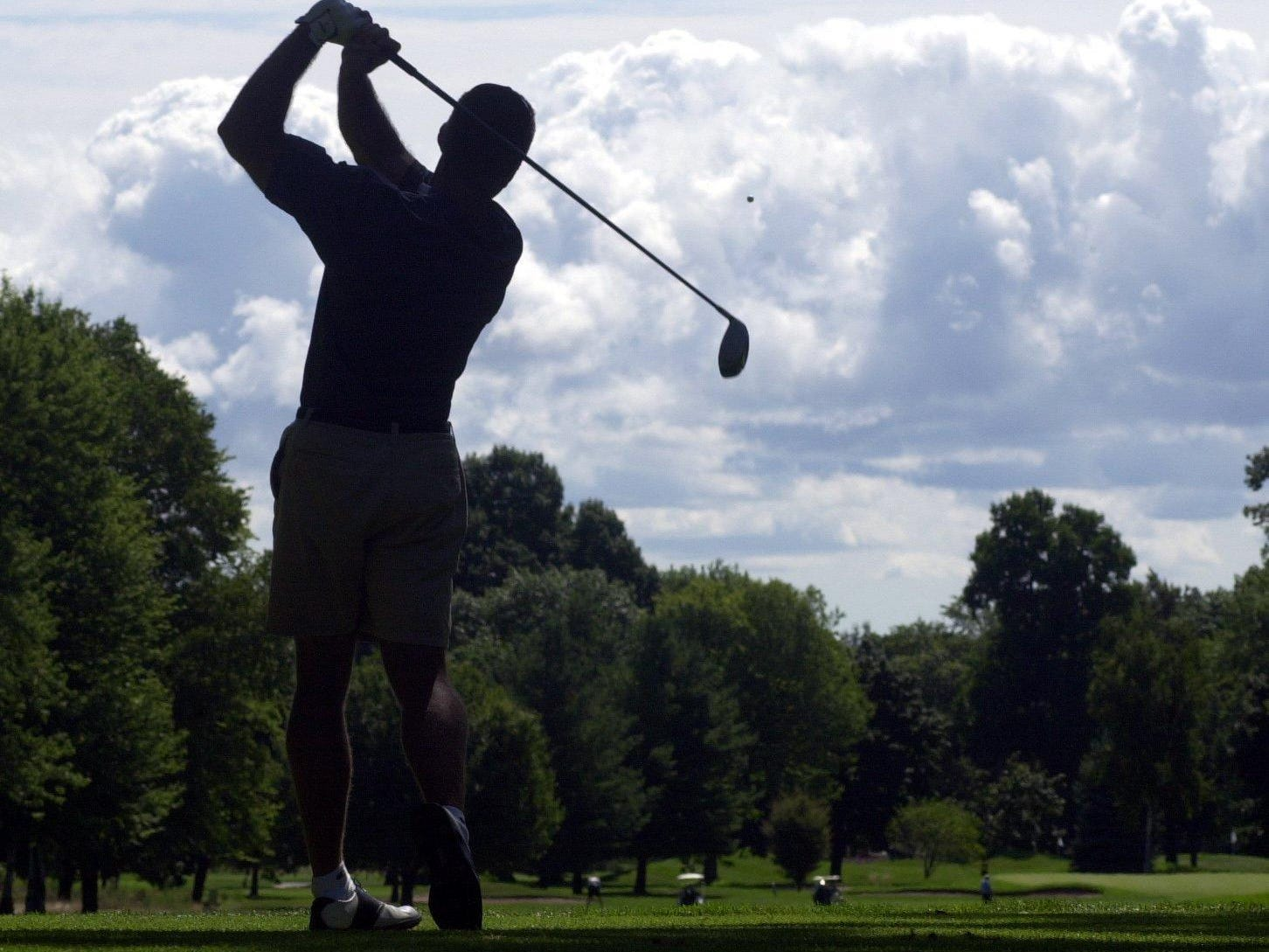 """Jay Ogden hits a tee shot on the seventh hole at the 2001 Port Huron Golf Club Invitational. Anthony Gholz Jr.'s book on the club, """"One Hundred Fifteen Years of Golf in Port Huron,"""" is on sale at blurb.com."""