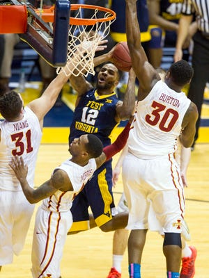 West Virginia Mountaineers guard Tarik Phillip (12) is fouled as he drives to the basket during the second half against the Iowa State Cyclones at the WVU Coliseum on Tuesday, Feb. 22, 2016, in Morgantown, W. Va.
