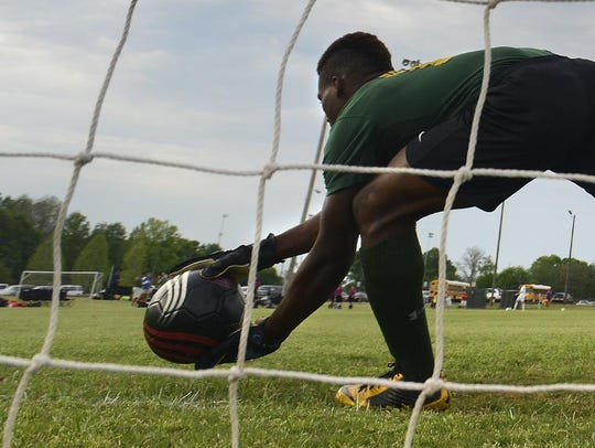 Carver's Justin Lewis warms up at goalie before the