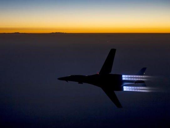 A U.S. Air Force jet flies over northern Iraq.