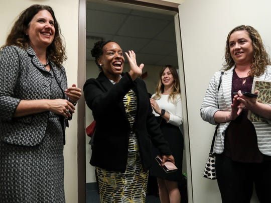 Attica Scott is the first African-American woman serving in Kentucky's state Legislature in the past 20 years. She represents District 41 in Jefferson County. Here, she's seen greeting women at an Emerge Kentucky seminar in Frankfort. The group is looking to increase the number of Democratic women in office.