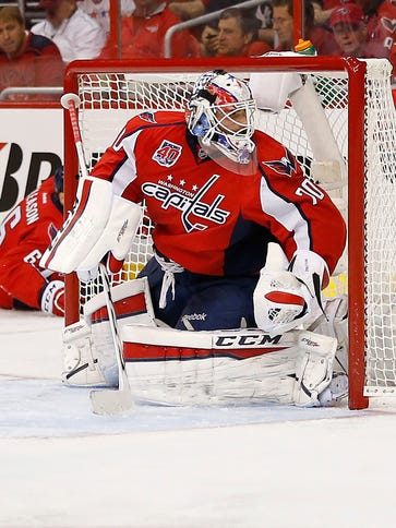 Capitals goalie Braden Holtby watches Rangers center