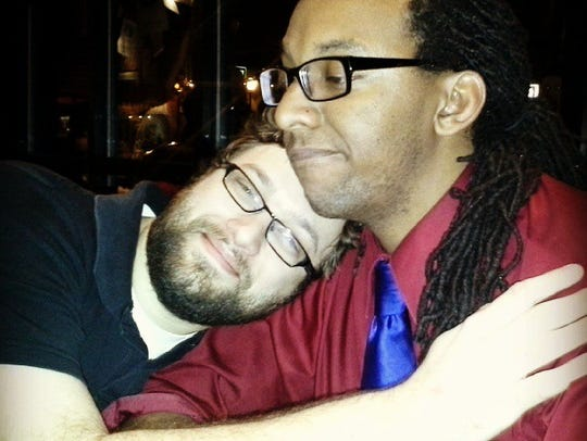 Andrew Taylor hugs his best buddy, James Green, in
