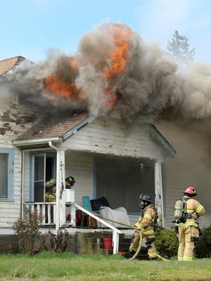 Bremerton firefighters prepare Wednesday to fight the High Avenue fire.