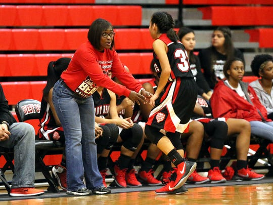 West Oso's head coach Cheryl Fillmore talks to Larissa Lopez during the Roy Williams Holiday Tournament on Wednesday, Dec. 28, 2016, at West Oso High School in Corpus Christi.