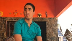 Juan Manuel Montes, 23, speaks in a relative's home