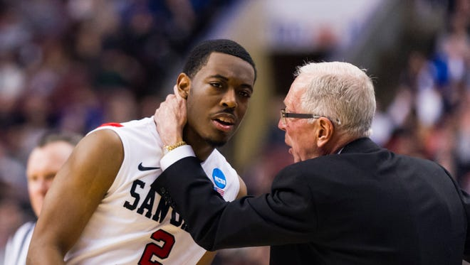 San Diego State Aztecs head coach Steve Fisher talks with guard Xavier Thames (2) during the first half against the Florida Gulf Coast Eagles during the third round of the NCAA basketball tournament at Wells Fargo Center.