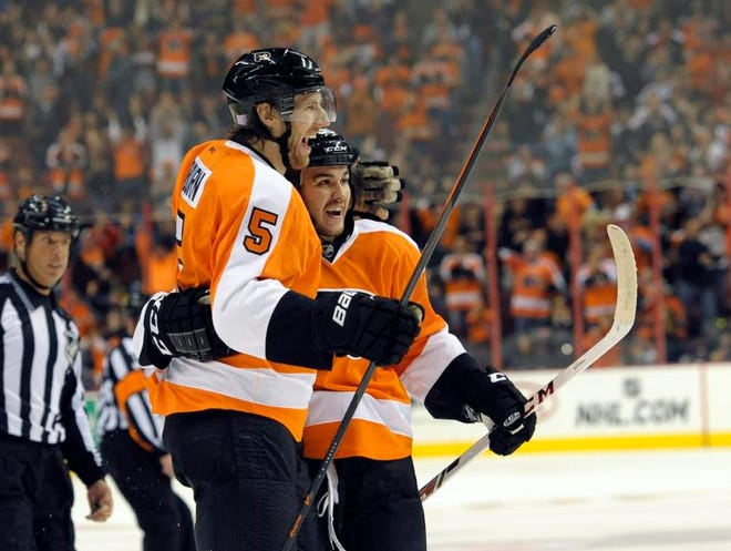 Flyers defenseman Braydon Coburn (5) celebrates his goal with center Zac Rinaldo in the first period of Tuesday's game.