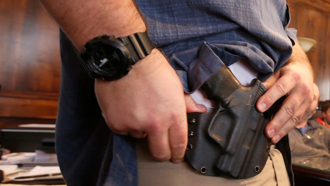 A state law allows public buildings to ban firearms, but a Senate bill sought an exception for concealed-carry permit holders.