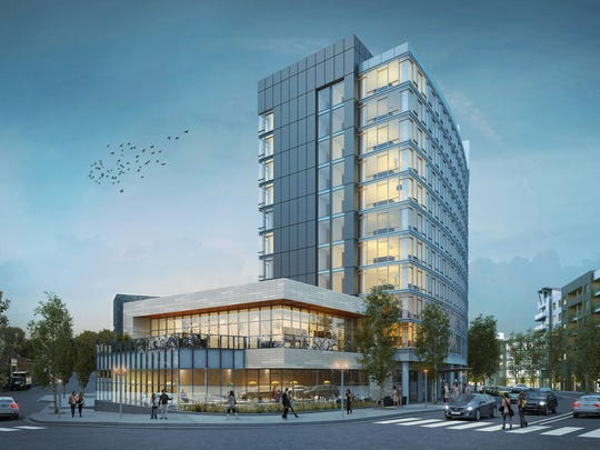 An artist's rendering shows the 12-story, 224-room Thompson Hotel, which is going to be built in the Gulch behind The Station Inn music venue.