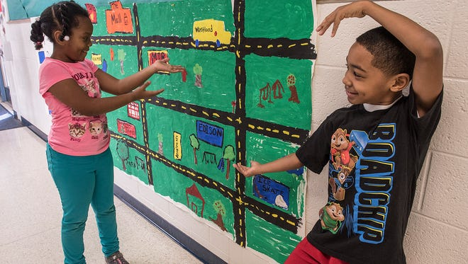 Isabel Rawlings and Alex Patterson, both second graders at Edison Elementary, present the city map, as seen by their second grade class.