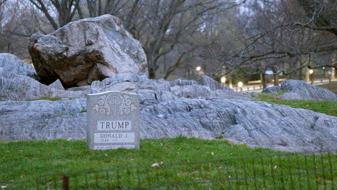 """In this March 27, 2016, photo provided by Molly Krause Communications, a headstone bearing Donald Trump's name in shown in New York's Central Park. The New York Times reported that police have identified the stone's artist as Brian Whitely. In a March 30 interview with the then unnamed artist, Whitely told the Times he was trying to remind the Republican presidential front-runner """"what kind of legacy he was leaving behind."""""""