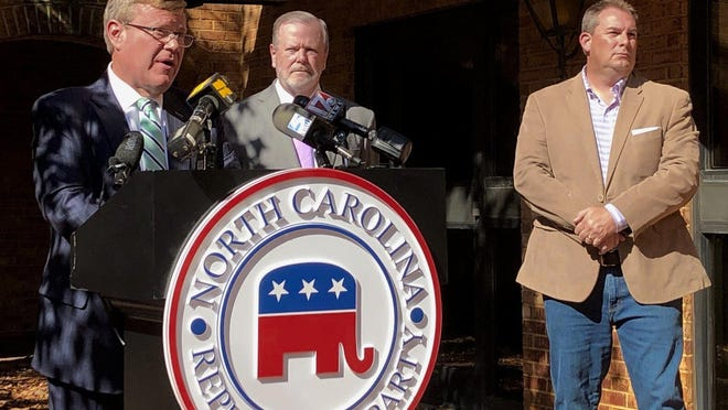 N.C. House Speaker Tim Moore, left, R-Cleveland, speaks to reporters, with Senate leader Phil Berger, R-Rockingham, and House Majority Leader John Bell, right, R-Wayne, at a news conference Nov. 4 at state GOP headquarters in Raleigh to discuss Election Day results (AP Photo/Gary D. Robertson).