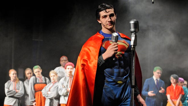 """Sophomore Grant Swingle plays the part of Superman on Wednesday during the Cathedral High School production of """"It's a Bird ... It's a Plane ... It's Superman."""""""