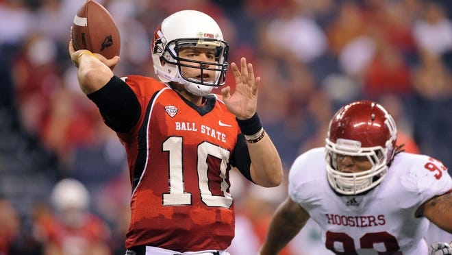 Ball State quarterback Keith Wenning eludes an Indiana defender in a 2011 game at Lucas Oil Stadium. He's hoping for another shot at playing in the NFL.