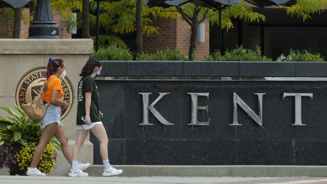 Kent State University's first day of fall classes. Students walk on campus wearing face coverings.