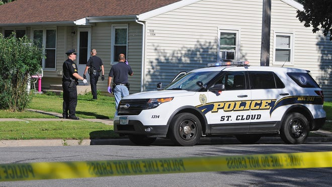 St. Cloud police investigate at 12th Avenue and 14th Street North in St. Cloud Tuesday.