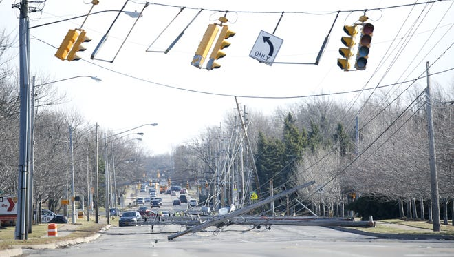 Power lines are down because of the strong winds on Long Pond Road in Greece and traffic was diverted at Northwood Drive.