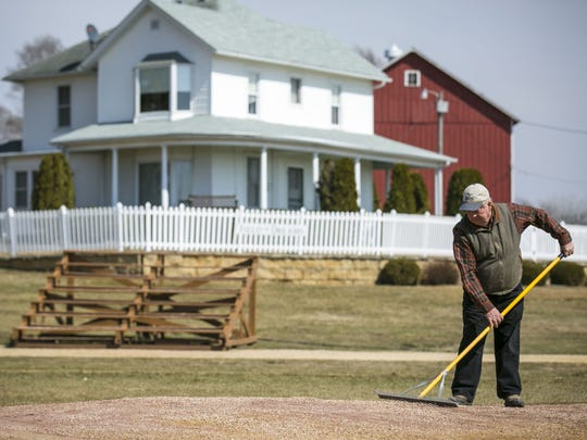 "Don Lansing, former owner of the house and farm at the ""Field of Dreams"" film site near Dyersville, still prepares the diamond and mows the grass for visitors."