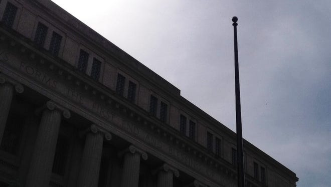 Someone cut the U.S. and other flags from the pole in front of the Hamilton County courthouse.