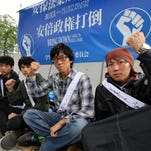 University students stage a hunger strike in front of the National Diet building in Tokyo on Aug. 28, 2015, to protest  Japanese Prime Minister Shinzo Abe's controversial security bills, which would allow offensive actions by the country's armed forces for the first time since the end of World War II.