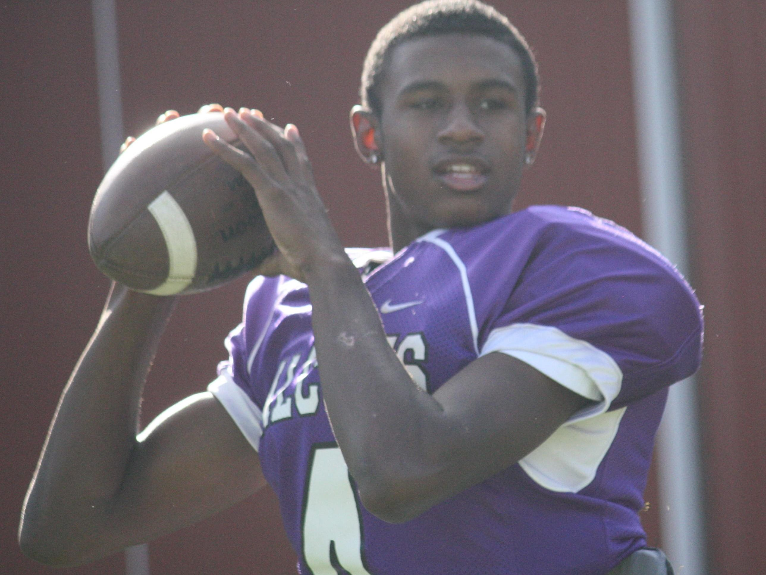 Aiken High School senior quarterback Samonte Griffin warms up before practice on Aug. 12.