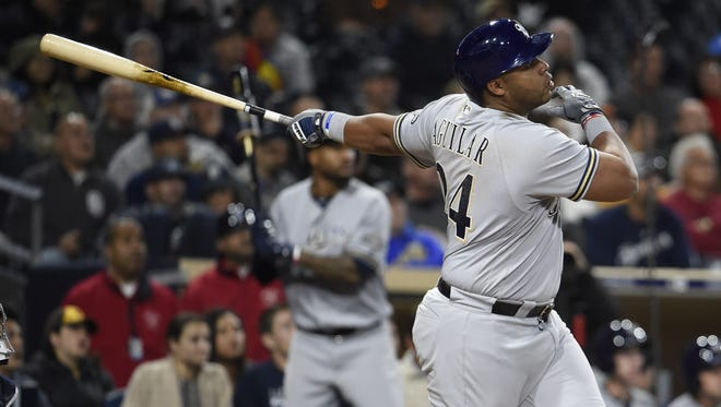 Jesus Aguilar of the Brewers hits a solo home run during the sixth inning.