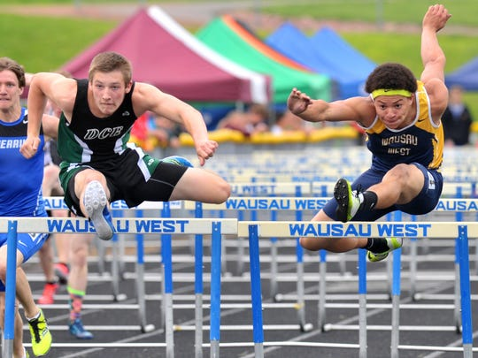 Konner Fierek, left, is the WIAA Division 1 defending champion in the 300 hurdles.