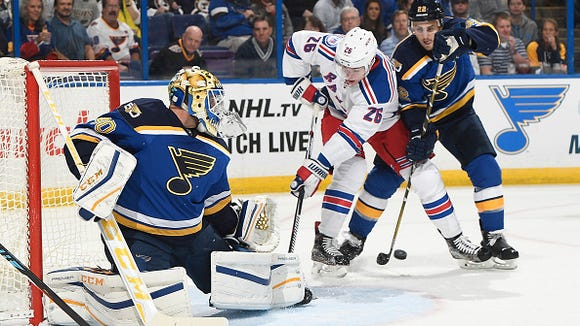 Carter Hutton makes a save on Jimmy Vesey (26), as New Rochelle's Kevin Shattenkirk defends Saturday in St. Louis.