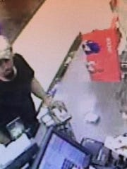 According to a surveillance photo, one of the suspects allegedly visited another local store before the Sudden Service robbery.