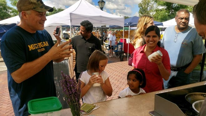"""John Perini of Farmington and daughter Sara discover the """"old world"""" way of making butter with Chef Brian Kanak a regular contributor to the markets informative """"Cook'n at the Market"""" chef series, sponsored by Challenge Butter."""