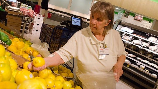 Curbside shopper Karen Kresnak  works at the Meijer  at Knapps Corner in Grand Rapids.