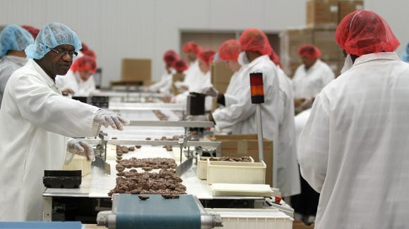 Workers hand sort Turtles made at DeMet's Candy Co. in Big Flats in 2012. The Southern Tier Upstate Revitalization Plan proposes $2 million in aid toward the company's nearly $19 million expansion of the plant. JENNIFER KINGSLEY / STAFF PHOTO