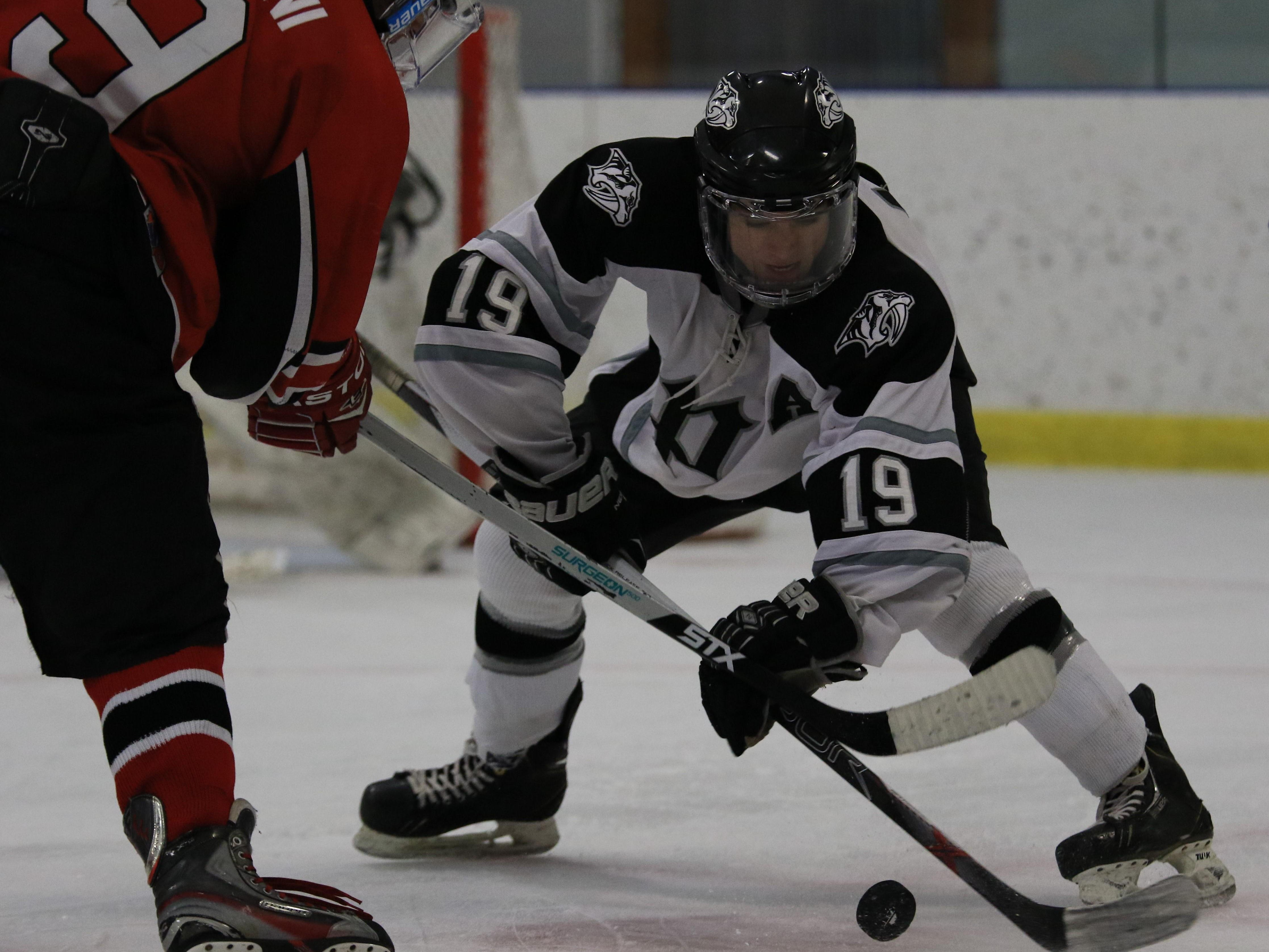 Squaring off during a faceoff are Canton's Brian Oldani and Plymouth's Alex Bump.