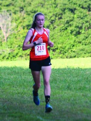 Macomb's Olivia Bishop runs during a meet earlier this season.