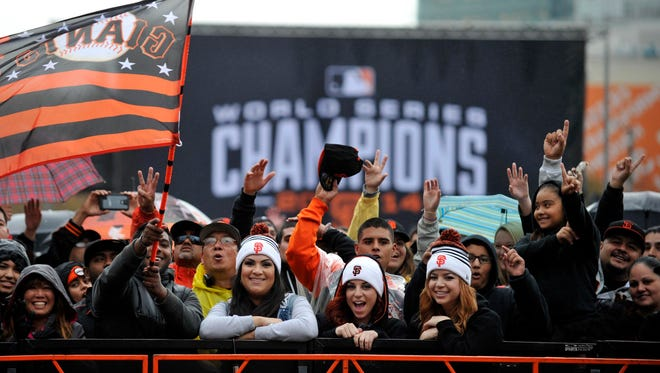 Giants fans celebrate before the World Series victory parade at City Hall in San Francisco. The Giants defeated the Royals in seven games.