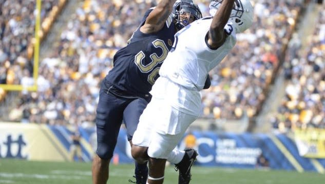DeAndre Thompkins reels in a 39-yard catch early in the fourth quarter of Penn State's game at Pitt on Saturday.