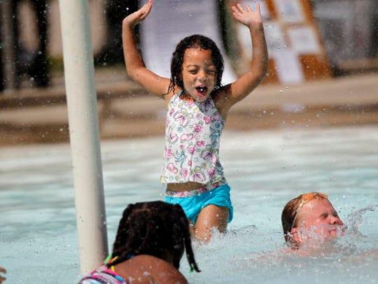 SPLASH - Makayla Stanley, age 6, cools off at the Humboldt