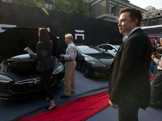 -RENBrd_05-11-2014_RGJ_1_F008~~2014~05~09~IMG_China_Tesla__jhuette_1_1_PM79S.jpg