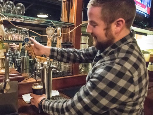 Kyle Sweet pours a Starboard Stout at Arcadia Ales