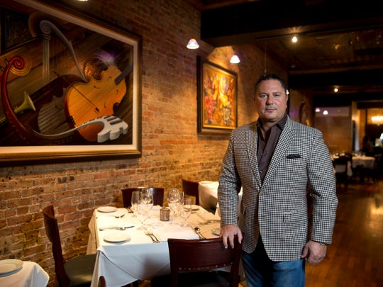 Restaurateur Steven Botta of Freehold Township, shown in the dining room of his Brando's Citi Cucina in Asbury Park, will reopen Fromagerie in Rumson in June.