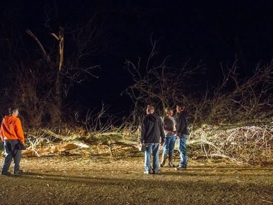People survey storm damage Thursday, April 9, 2015,