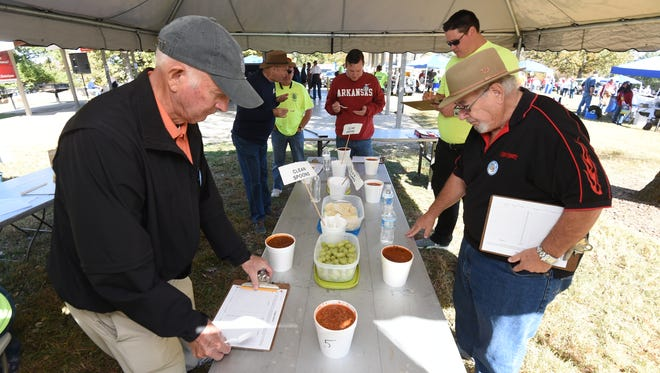 The judges carefully taste the chili offerings from the competitive teams during the 20th Annual Hillbilly Chili Cook-off.