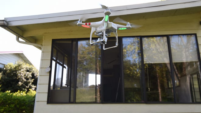 It is illegal in Arkansas to use a drone to invade someone's privacy and film them while they're in a state of undress. Shooting one down because it's over your property also can get you in trouble, potentially felony trouble depending on the drone's value.