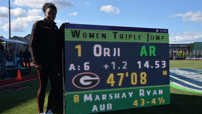 Georgia sophomore Keturah Orji of Mount Olive poses with scoreboard after winning the  triple jump in an American record 47-8 (14.53m) during the NCAA Track and Field Championships. (Mandatory Credit: Kirby Lee-Image of Sport)
